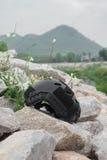 Modern combat helmet on ground. Stock Photos