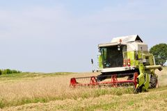 Modern combine in the field during harvesting Stock Photography
