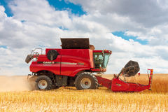 Modern case combine at harvest time Royalty Free Stock Photo