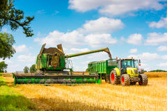 Modern john Deere combine and Claas tractor Stock Photo