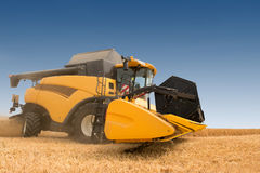 Modern combine harvester in action. Stock Images