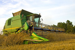 Modern Combine Harvester At Work Royalty Free Stock Photos