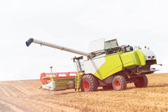 Modern combine harvester on stubble field at end of summer.  stock photos
