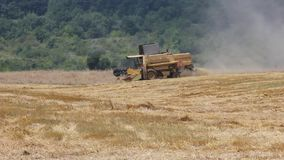 Modern combine harvester at work stock footage