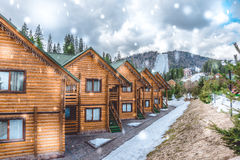 Modern and comfortable wooden cottages. Accommodation in the ski resort `Bukovel`, Ukraine. Winter activities in Eastern Europe. Modern and comfortable wooden Royalty Free Stock Photo