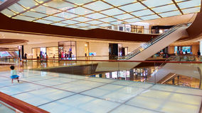 Modern commercial building shopping mall. Interior of modern business commercial building. Inside retail shopping mall center with fashion stores and shops Stock Image