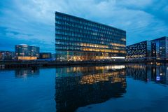 Modern commercial buildings beside the canals. Copenaghen scene during night royalty free stock image