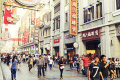 Urban city street China. Modern urban commercial shopping street view. City pedestrian mall with crowded people in downtown in Guangzhou, China Stock Images