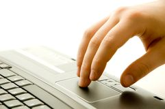 Modern communication. Hand on laptop touchpad Royalty Free Stock Image