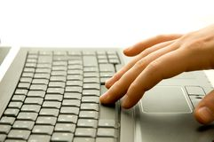 Modern communication. Hand pushing the space button on notebook keyboard Royalty Free Stock Photo