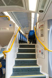 Modern Commuter train stairs and seats Royalty Free Stock Images