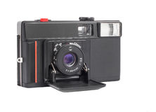 Modern compact analog camera on film 35mm format isolated on a white background. Compact camera with lens on film 35mm format royalty free stock photos
