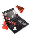 Modern compact notebook with christmas decoration Royalty Free Stock Image
