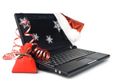 Modern compact notebook with christmas decoration Stock Photos