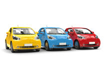 Modern compact urban electric cars in primary colors Royalty Free Stock Images