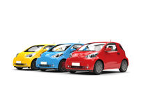 Modern compact urban electric cars in red, blue and yellow Stock Photo