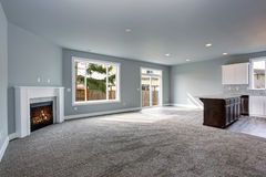 Modern and completely gray interior of home. Modern and completely gray unfurnished interior of luxury town house royalty free stock photos