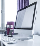 Modern computer on a desk Stock Images