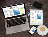 Modern computer devices with news site. Modern computer devices laprop, tablet and phone with news site screen Royalty Free Stock Images