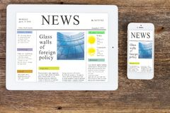 Modern computer devices with news site. Modern computer devices  tablet and phone with news site screen Stock Image