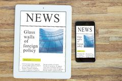 Modern computer devices with news site. Modern computer devices  tablet and phone with news site screen Stock Images