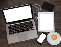 Modern computer devices. Set of modern computer devices - laptop, tablet and phone with cup of coffee stock image