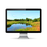 Modern computer display with landscape wallpaper Royalty Free Stock Photos
