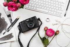 Modern computer keyboard, pink flowers and photo camera on white Stock Image