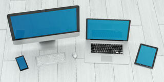 Modern computer laptop mobile phone and tablet 3D rendering. Modern computer laptop mobile phone and tablet on wood floor 3D rendering Stock Photography