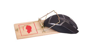 Modern computer mouse in a mousetrap Royalty Free Stock Image