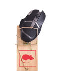 Modern computer mouse in a mousetrap Royalty Free Stock Photography