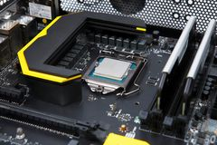 Modern computer processor and motherboard Stock Images