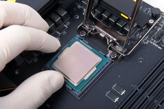 Modern computer processor and motherboard Royalty Free Stock Images
