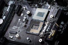 Modern computer processor on motherboard socket. Modern computer processor on motherboard socket with focus on cpu socket pins and circuits from motherboard Royalty Free Stock Photography