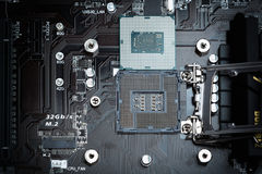 Modern computer processor on motherboard socket. Modern computer processor on motherboard socket, focused on pins and circuits with silver bolts Stock Images