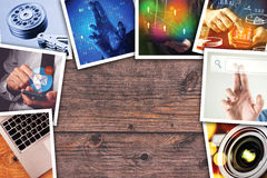 Modern computer technology photo collage. Stack of tech and internet themed polaroid pictures on wooden office desk with copy space stock image