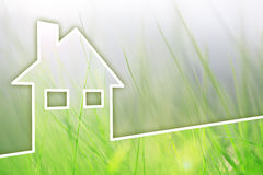 Modern concept eco home house background. Eco green house healthy living on sunny grass copy space background. Concept Royalty Free Stock Photography