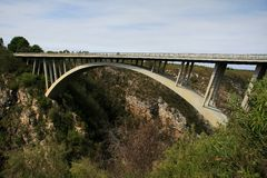 Modern Concrete Bridge. Concrete bridge and arch spanning a river gorge in South Africa Stock Photos