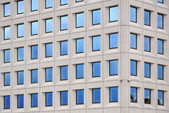 Modern concrete building with blue sky windows Stock Photo