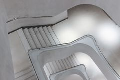 Modern concrete spiral stairs. With white lights Stock Photos