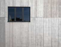 Modern concrete wall with black window Stock Image