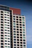 Modern Condo Balconies on Blue. A modern high rise condo tower on a blue sky Stock Photo