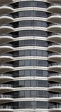 Modern condo building exterior. Closeup exterior view of approximately ten stories of a modern luxury condominium complex with balconies Stock Photo