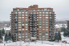 Modern condo buildings with huge windows in snow stock image