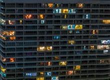 Modern condo by night Royalty Free Stock Photos