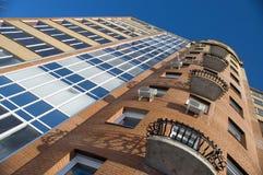 Modern Condominium. Modern building from a brick. Glass balconies Royalty Free Stock Photo