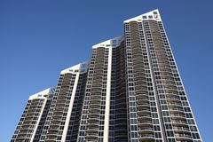 Modern Condominium. On a clear blue sky royalty free stock image