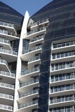 Modern Condominium. On a clear blue sky royalty free stock photo