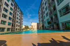 Modern condominium with blue pond. House and flat background stock images
