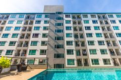 Modern condominium with blue pond. House and flat background royalty free stock photo